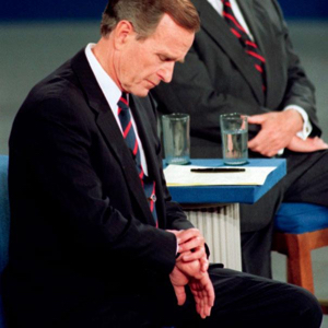 President George H.W. Bush looks at his watch during the 1992 presidential campaign debate at the University of Richmond, Va. on Oct. 15, 1992 (Photo: Associated Press)