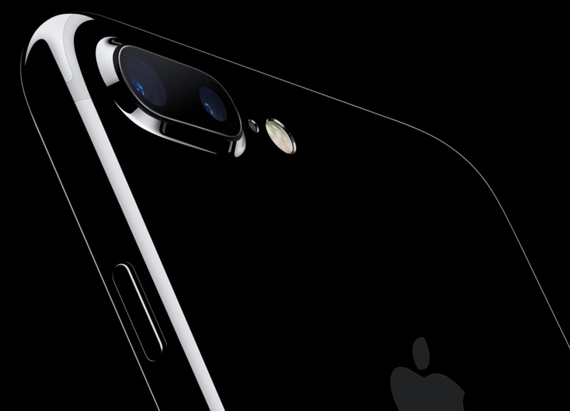 """Apple.com's introductory image for """"iPhone 7"""" is the top rear of the Jet Black iPhone 7 Plus model featuring its dual-camera and Quad-LED True Tone flash"""
