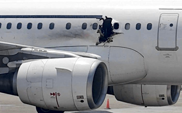A hole was blown in the side of a plane last year caused by an explosive-filled laptop  (Photo: AP)