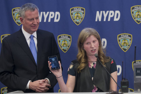 Two Morons and a Dinosaur: Mayor Bill de Blasio and Jessica Tisch, police deputy commissioner of information technology tout Windows Phone. (Photo: Chad Rachman)