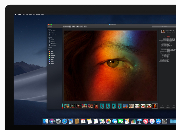 Dark Mode transforms the Mac desktop with a dramatic darkened color scheme where content pops and controls recede into the background.